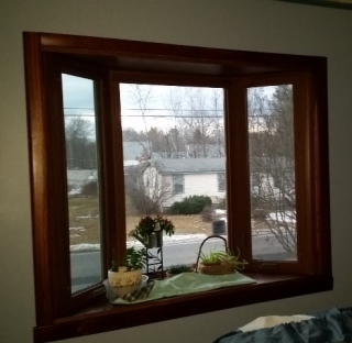 Living room bay window trimmed
