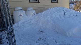 Snow shoveled from propane tanks-angle