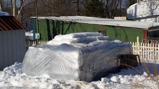 Snow scraped from pellet pile