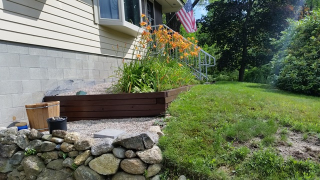Stained timbers new flower bed