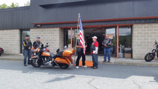 Blake handing off flag to Granite State Chapter