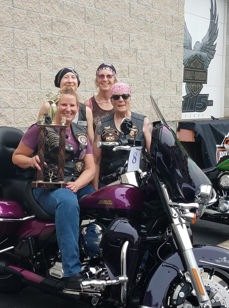 4 ladies at Heels and Wheels with trophy