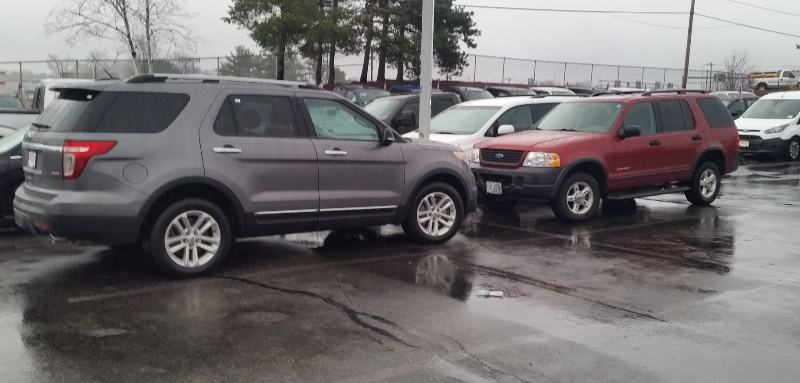 2004 and 2014 ford explorers facing 1