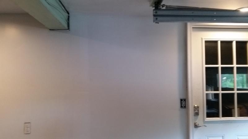 Painted wall to left of door
