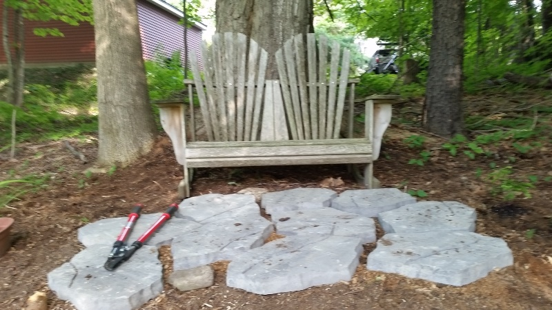 Start of sitting area in woods-close