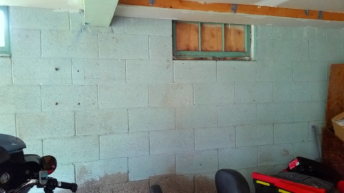 Unpainted cinder block wall