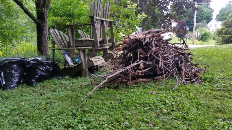 Wood pile by chairs-from end