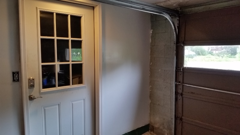 Painted wall to right of door