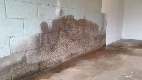 Garage wall before with outline of bike