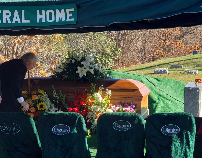 Casket at beginning with flowers