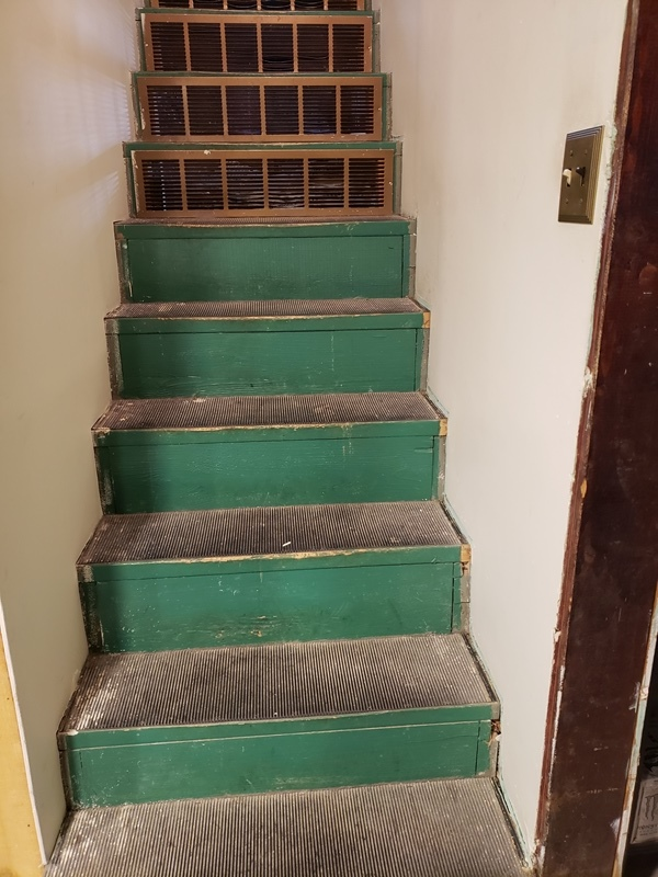 Basement stairs trim off right side-trnd