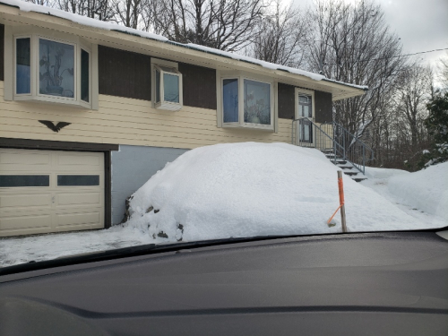 Snow at high side of garage